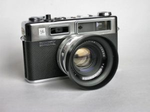 "An original Yashica Electro 35 from 1966 (with lens hood). Notice the absence of the ""G"" before Yashica, absence of the word ""COLOR"" on the lens, and the all metal film advance lever."