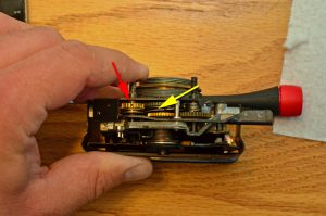 The red and yellow arrows indicate where I added lithium grease to help lube the camera.