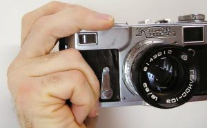 "This is called ""The Contax Grip"".  Make sure you do not block the rangefinder window!"