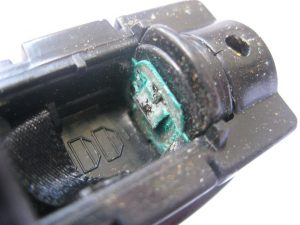 Battery corrosion may be greenish or white in color.