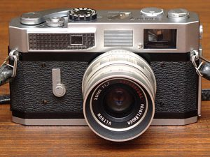 This Canon 7 rangefinder has a very large selenium light meter in the top left corner.