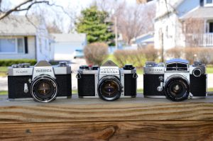 The Pentax Sv is flanked by a Yashica TL-Super from 1966 and a Miranda Sensorex from 1967. The Pentax is shorter, narrower, and about 250 grams lighter than the other two.