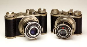 A pre war Edinex and a Gewirette medium format camera.  Notice the small size of the Gewirette and the nickel finish on both cameras.  Also notice the round accessory shaft on top of the Edinex.