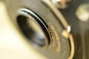 """It's hard to read, but the ring around the lens says """"Made only for EASTMAN KODAK CO by BAUSCH & LOMB OPTICAL CO Rochester N.Y."""""""
