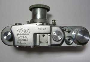 An original FED/Zorki camera made in 1948 which shows both the FED and Zorki logos on the top plate. Notice the KMZ logo does not yet show the bent arrow which would later be added to the logo.