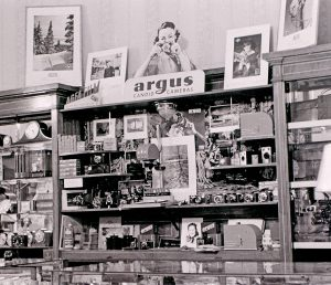An Argus display at an Oklahoma drug store, circa 1940 by Charles Dunlap.