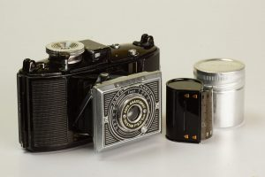 An example of an early AGFA Karat 6.3 with the art deco front panel. Sitting beside the camera is a Karat film cassette and canister.
