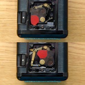 This is the Argus 75's shutter. The top picture is uncocked, and the bottom is cocked. Notice the red painted piece of the shutter blade which moves into position where the taking lens would be.
