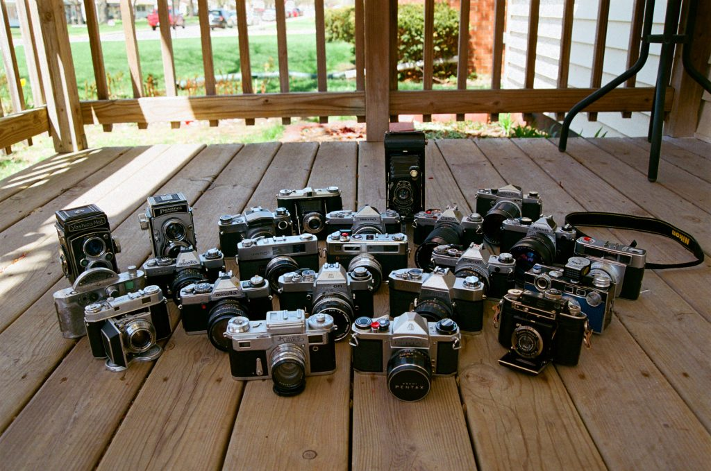 My collection of cameras as of April 2015. This was taken with a Nikomat FTn and 50mm Nikkor Ai lens,