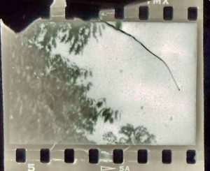 This is actual film that was damaged by the sprocket shaft in a stiff Kodak 35.