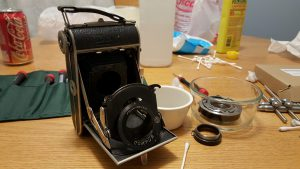 The Dolly chassis with the shutter and lens removed. You can see parts of it already disassembled on the table.