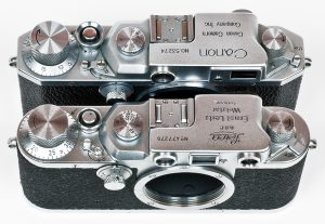 An early Canon IIB compared to a Leica IIIc. Notice how similar the two are. Canon's rangefinder designs would evolve as the years went on.
