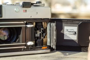 The Quick Load feature used a spring loaded plate that would hold the film in the necessary position simplifying the film loading process.