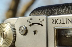 "This switch must be in ""WIND"" mode to load film and get it to frame one. Once the film is just about to show the number '1' in the red window, you move this switch to the ""1-8"" position."