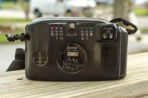 """The back of the camera features the 6 mode buttons, the date imprint controls, the """"joystick"""" and that really tiny viewfinder."""