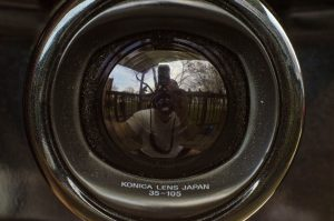 The built in lens cap is semi-transparent when the camera is off, but when switched on, automatically rotates back into the camera.