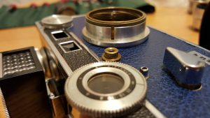 The threaded brass collar inside of the lens mount near the top of this image is the helical on an Argus C3. The helical goes in about 8 different positions, only one of which is correct.