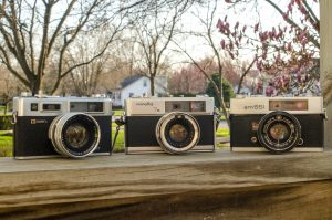 The Minolta Hi-Matic 7s compared to two other 60s rangefinders, the Yashica Electro and Wards am551 (Konica Auto S2).