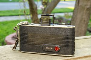 The back of the camera is pretty typical of a 1930s folding camera. The red window is visible for advancing the film.