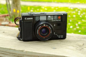 The Canon AF35M is basically a solid plastic brick, disguised as a camera.