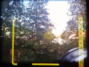 When looking through the viewfinder, you see parallax corrected frame lines, and an exposure scale showing EV values.