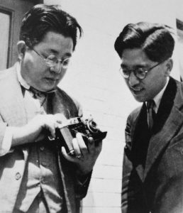 Seiichi Mamiya and Tsunejiro Sugawara showing off a Mamiya Six sometime around 1940.