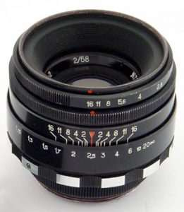 This is not my exact lens, but it shows both the preset ring on top, and then immediately below it is the aperture ring. Both must be used to properly set the correct aperture size while shooting.