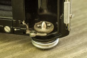This little catch mechanism senses a hole in 828 film that stops the film advance upon reaching the next frame.