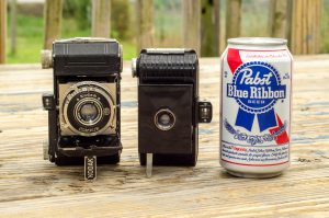 The Bantam is small. Compared to the Kodak Retina I which was considered to be a 'miniature' camera in it's day, and a can of Wisconsin's finest.