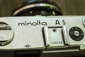 The Minolta A5 is quite an elegant camera. The logo is engraved prominently into an uncluttered top plate.