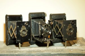 Three different variants of the Vest Pocket Kodak, which was the first camera designed to use 127 film.